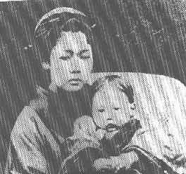 Heusken's wife, o-Tsuyu, with their child.