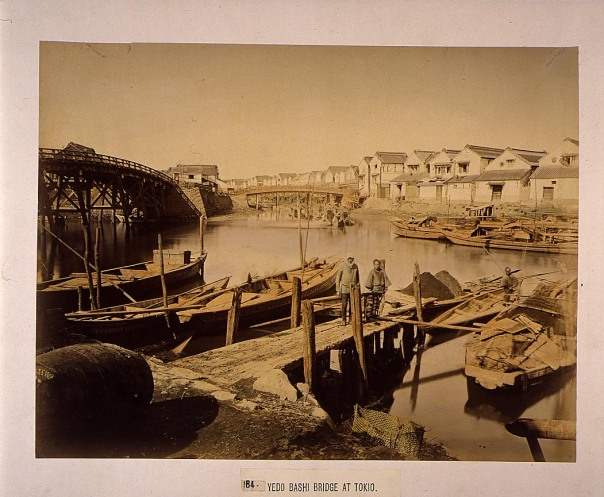 Edobashi in the late Edo Period. Note the white warehouses that line the river. This is a typical view of the area. The river was used for transporting goods and so the warehouses were very important.
