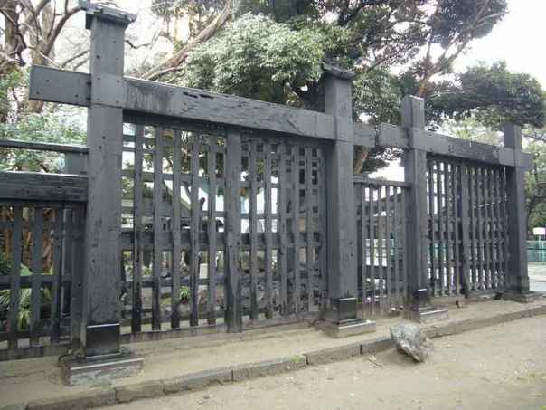 "The Kuromon - ""Black Gate"" of Kan'ei-ji. Imperial forces routed the shogitai (holed up in the temple precincts). The imperial army entered the area through this gate with fast breech-loading rifles and cannon. The shogitai were armed with swords and traditional weapons. This gate and the other structures that survived the Battle of Ueno are riddled with bullet holes that you can still see today -- even in this photograph!"