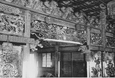 A close up of the wooden carvings decorating the inside of the haiden.