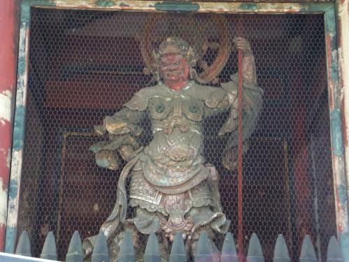 多聞天 (Tamonten, generally equivocated with the other Japanese kami, Bishamonten - one of the 7 gods of good luck).