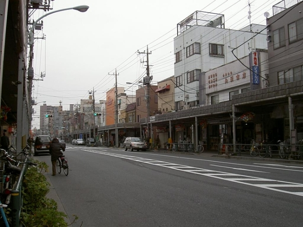 A Google search said this is  today's Kotsu Dori. The architecture looks like bubble economy style. Notice how low the buildings are. (but since I haven't been in a while, I don't know if this is how Kotsu Dori looks today.)