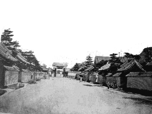 """If you walk up the street from the above photo, you'll end up at what is called Shiba Daimon today. This street led directly to the Tokugawa Funerary Temple, Zojo-ji. The gate is called Daimon """"the Big Gate"""" and once you crossed it, you entered the outskirts of the temple precinct."""