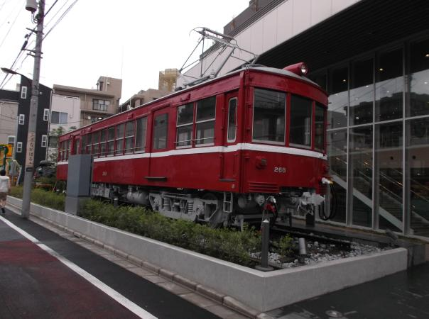 This decommissioned Keikyū carriage sits in front of the Katō Hobby Center Showroom, a model train shop.