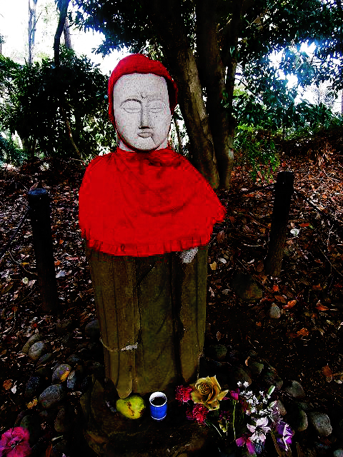 This is the Headless Jizō. People gave it a new head. It's said to curse anyone who touches it and anyone who drives to the site in a white car. People move the head and body around the temple ruins so it's rarely in the correct place... or in one piece.